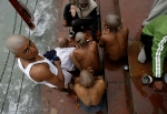 Hindu devotees pray on the banks of the river Ganges in Haridwar